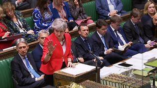 La Première ministre britannique, Theresa May, s'exprime devant le Parlement britannique, le 12 mars 2019. (PRU / AFP)