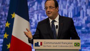 A Sao Paulo (Brésil), François Hollande a annoncé, le 12 décembre 2013, qu'il souhaitait la création d'un fonds européen pour mener des opérations dans des pays en crise, comme en Centrafrique. (NELSON ALMEIDA / AFP)