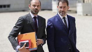 Le Premier ministre, Edouard Philippe, et Christophe Castaner, le porte-parole du gouvernement, quittent l'Elysée, le 22 juin 2017. (THOMAS SAMSON / AFP)