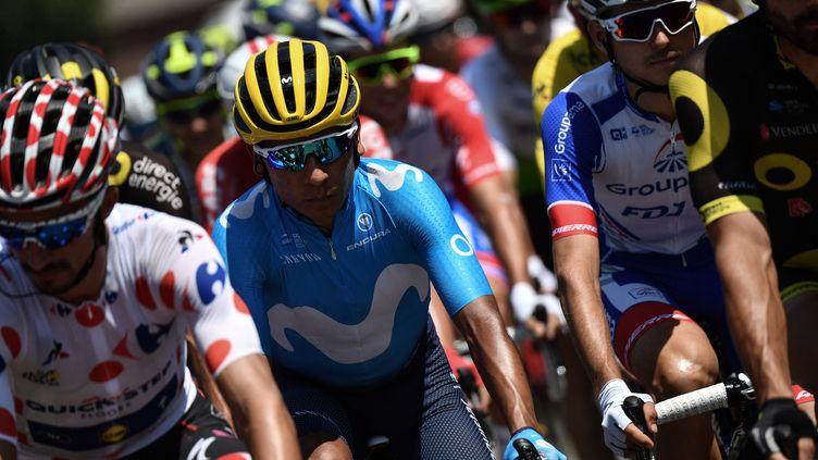 Le Colombien Nairo Quintana roule avec le peloton dans la 18e étape du 105e Tour de France entre Trie-sur-Baise (Hautes-Pyrénées) et Pau (Pyrénées-Atlantiques), le 18 juillet 2018. (JEFF PACHOUD / AFP)