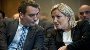 Florian Philippot et Marine Le Pen, respectivement vice-président et présidente du Front national, le 10 décembre 2014 à Paris. (NICOLAS MESSYASZ/SIPA)