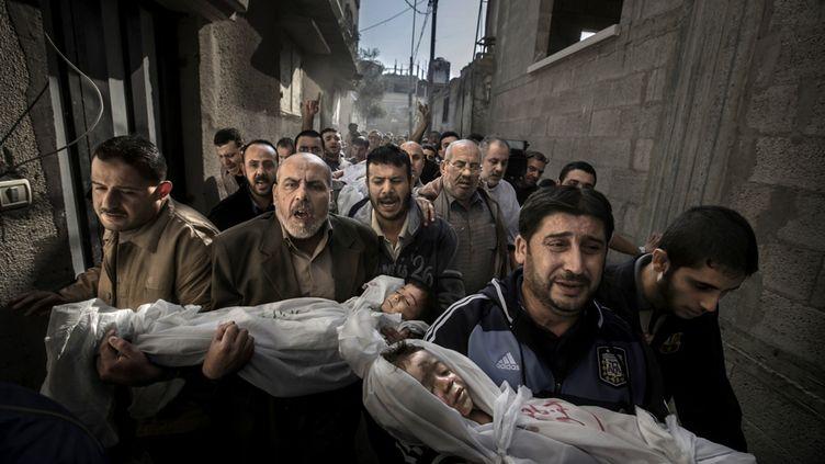 """""""Funérailles à Gaza"""", du photographe suédois Paul Hansen, a remporté le World Press Photo Award le 15 février 2013 à Amsterdam (Pays-Bas). (PAUL HANSEN / DAGENS NYHETER)"""