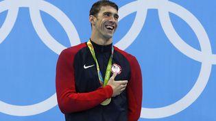 L'Américain Michael Phelps, médaillé d'or lors de la finale du 200 m papillon à Rio, le 9 août. (ODD ANDERSEN / AFP)