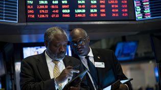 Des traders à la clôture de NYSE, le 12 août 2019 à Wall Street, à New York. (JOHANNES EISELE / AFP)
