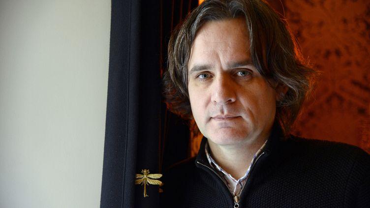 """Riss (Laurent Sourisseau), directeur de """"Charlie Hebdo"""", à Paris, le 24 avril 2015. (BERTRAND GUAY / AFP)"""