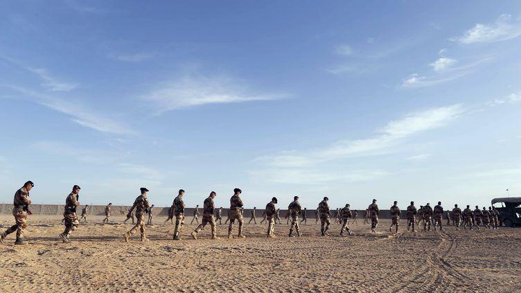 Les forces françaises en action, le18 mars 2013 dans la région de Tessalit au Nord-Mali. (KENZO TRIBOUILLARD / AFP)