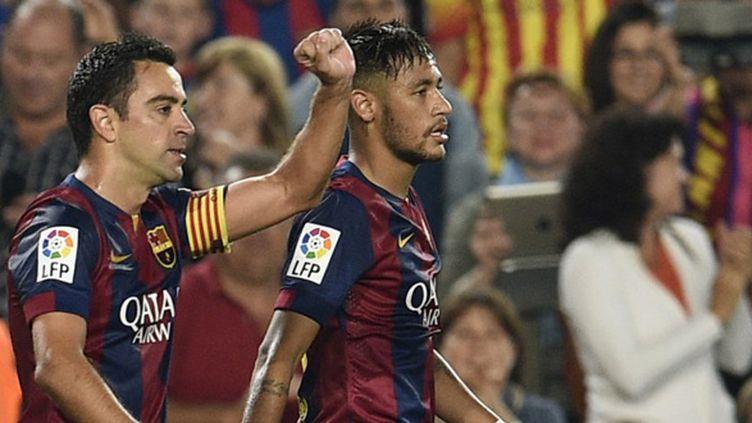 Xavi et Neymar (Barcelone) (LLUIS GENE / AFP)