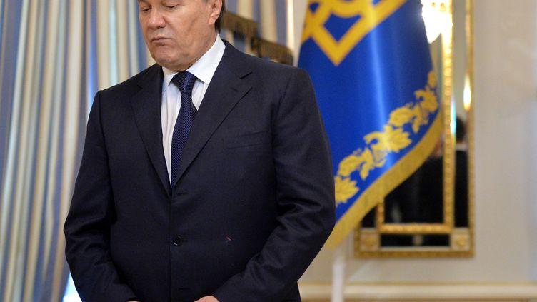 L'ancien président ukrainien Viktor Ianoukovitch avant la signature d'un accord avec l'opposition, le 21 février 2014. (SERGEI SUPINSKY / AFP)