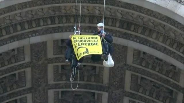 Opération de Greenpeace sur l'Arc de Triomphe et  la place de l'Etoile