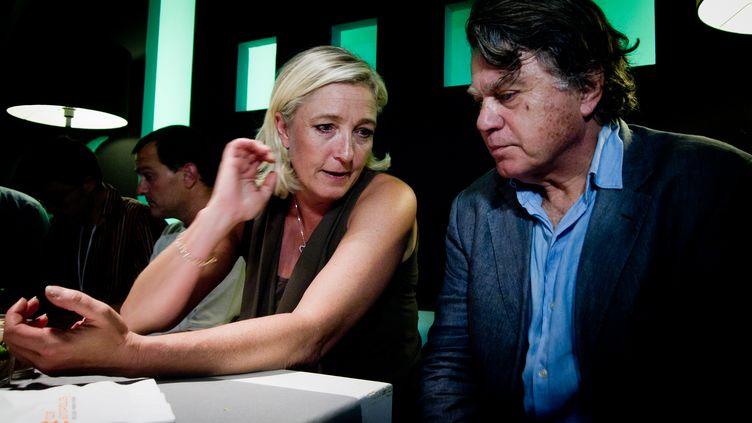 Marine Le Pen et le président de son comité de soutien Gilbert Collard, le 10 septembre 2011 à Nice. (JEAN-LUC RUZEMAURE / GETTY IMAGES)