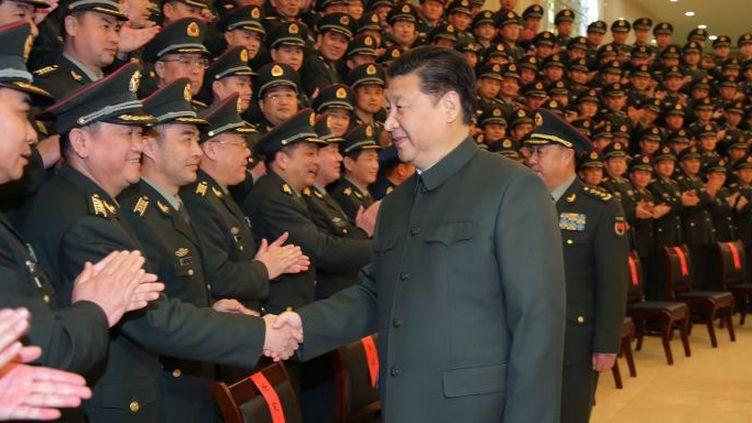 Le président chinois Xi Jinping, chef des armées, entend accroître son autorité sur l'Armée populaire de Libération (APL). (LI GANG / XINHUA /AFP)