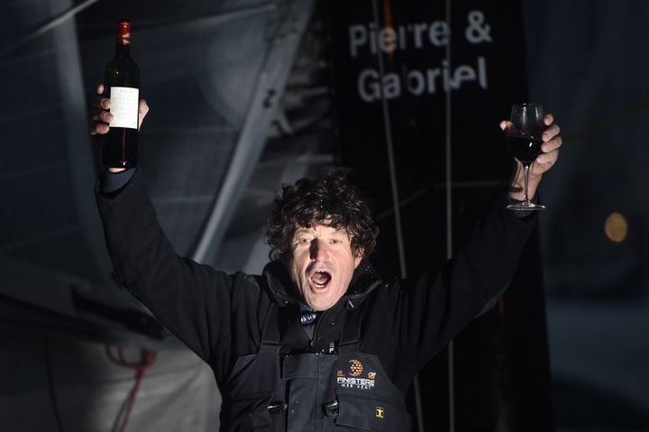 The skipper Jean Le Cam, glass of red in hand, celebrates his arrival in the Vendée Globe 2016, concluded in 6th place, on January 25, 2017, in Sables-d'Olonne (Vendée).  (JEAN-SEBASTIEN EVRARD / AFP)