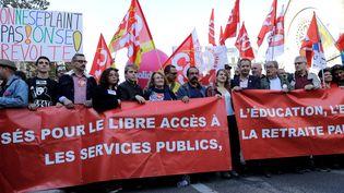 Le carré de tête de la manifestation organisée par les syndicats, le 9 octobre 2018 à Paris. (THOMAS SAMSON / AFP)