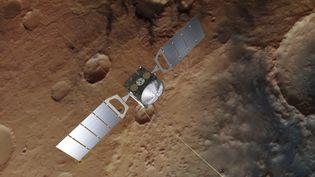 Une représentation de la sonde européenne Mars Express au-dessus de la planèterouge. (HANDOUT / EUROPEAN SPACE AGENCY / AFP)