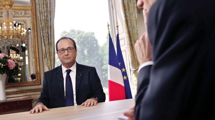 Le président de la République après son interview télévisée, le 14 juillet 2014, au palais de l'Elysée, à Paris. (THIBAULT CAMUS / AFP)