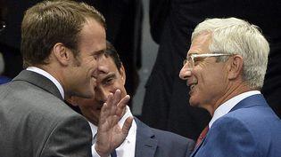 Emmanuel Macron (G.) et Claude Bartolone, dans les tribunes du Stade de France, à Saint-Denis (Seine-Saint-Denis), le 4 septembre 2014. (FRANCK FIFE / AFP)