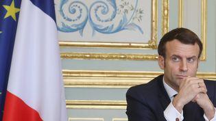 Le président de la République Emmanuel Macron, jeudi 19 mars à l'Elysée. (LUDOVIC MARIN / AFP)