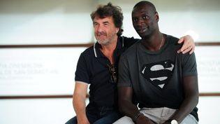 """Omar Sy et François Cluzet, les vedettes d'""""Intouchables"""" à San Sebastian en septembre 2011  (Rafa Rivas / AFP)"""