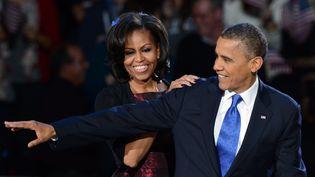 Barack et Michelle Obama en 2012 à Chicago où de nombreux habitants souhaitent le retour du couple, après la prochaine présidentielle (SAUL LOEB / AFP)