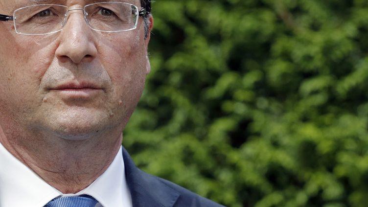 François Hollande, le 8 août 2013 à Marly-le-Roi (Yvelines). (CHRISTIAN HARTMANN / AFP)