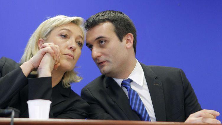 La présidente du FN, Marine Le Pen, et le vice-président, Florian Philippot, lors d'une conférence de presse au siège du parti, le 12 janvier 2012. (JACQUES BRINO / SIPA)