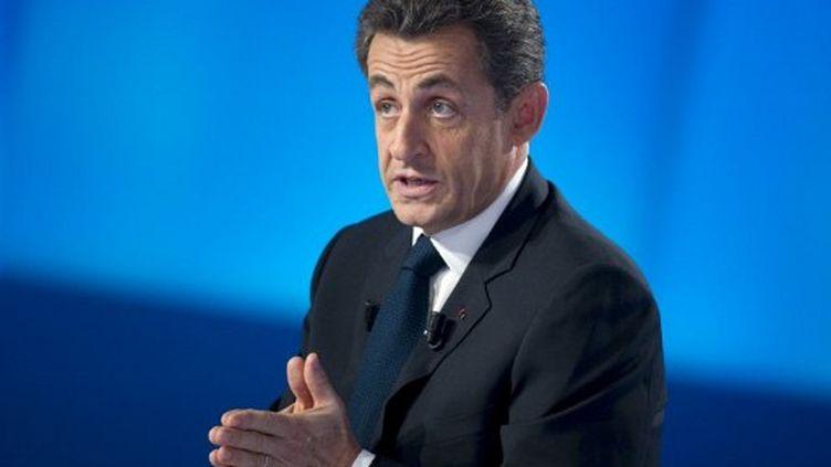 Nicolas Sarkozy, sur le plateau du Grand journal. (LIONEL BONAVENTURE / POOL / AFP)