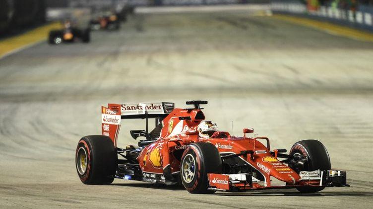 Sebastian Vettel (Ferrari), parti en pole position, s'est montré le plus rapide dans les rues de Singapour. (MOHD RASFAN / AFP)