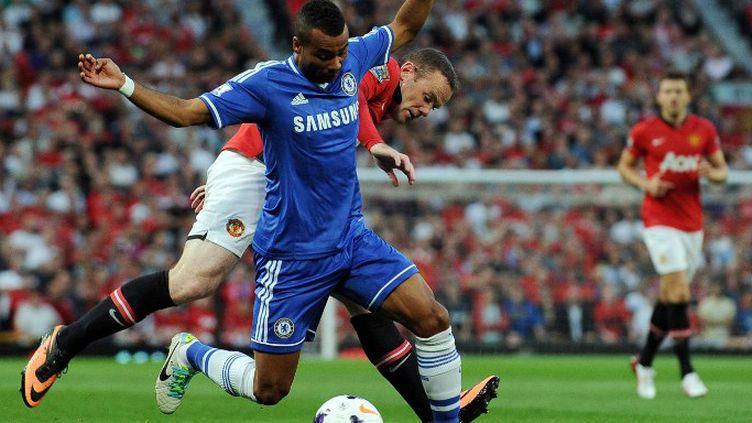 Wayne Rooney aux prises avec Ashley Cole (ANDREW YATES / AFP)