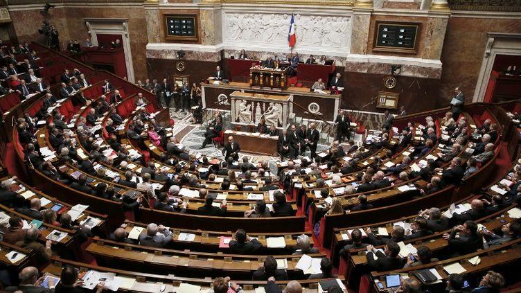 Les questions au gouvernement à l'Assemblée nationale, le 11 décembre 2013. (PATRICK KOVARIK / AFP)