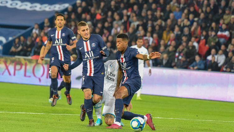 Les joueurs parisiens face à l'OM, au Parc des Princes, le 27 octobre 2019. (STEPHANE VALADE / AFP)