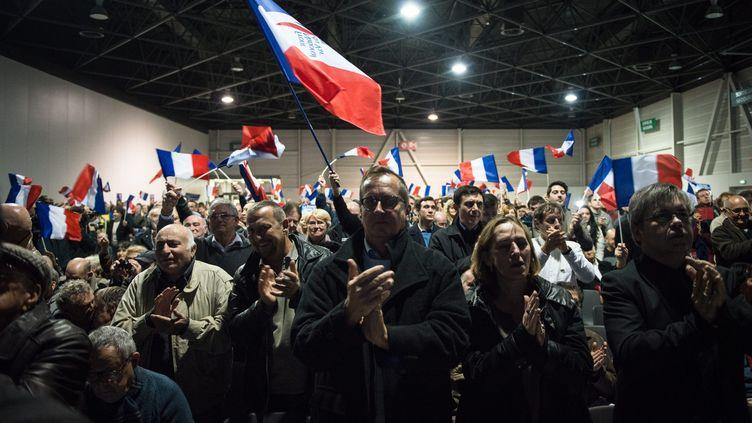 Des militants du Front national, lors d'un meeting, à Marseille (Bouches-du-Rhône), le 9 décembre 2015. (MAXPPP)