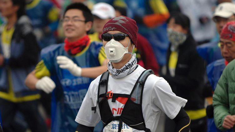 Un participant au marathon de Pékin 2014 (STR / AFP)