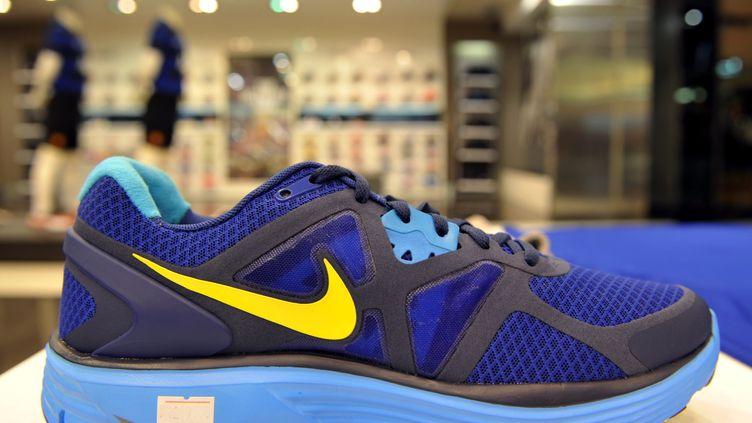 """L'équipementier américain Nike est cité dans l'enquête """"Paradise Papers"""". (ADEK BERRY / AFP)"""