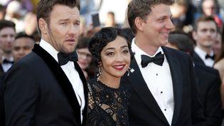 """L'acteur, Joel Edgerton,l'actrice, Ruth Negga et le réalisateur Jeff Nichols présentent le film """"Loving"""" au Festival de Cannes, en mai 2016. (ERIC GAILLARD / REUTERS)"""