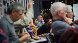 Des participants à une réunion locale dans le cadre du grand débat national, à Bollène (Vaucluse), le 28 février 2019. (CLEMENT MAHOUDEAU / AFP)