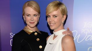 Nicole Kidman (G) et Charlize Theron (D) (2013)  (Michael Kovac / GETTY IMAGES NORTH AMERICA / AFP)