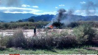 Les restes d'un des deux hélicoptères qui s'est écrasé près deVilla Castelli (Argentine), lundi 9 mars 2015. (GABRIEL GONZALEZ / AP / SIPA)
