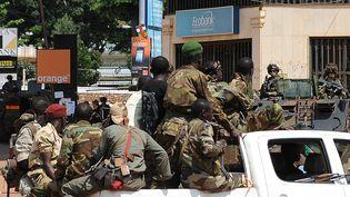 Les rebelles ex-Seleka dans les rues de Bangui (Centrafrique), le 8 décembre 2013 (SIA KAMBOU / AFP)