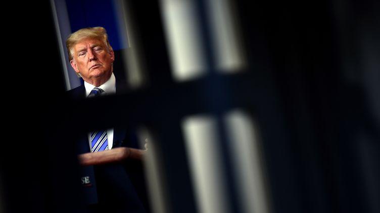 Le président américain, Donald Trump, lors de la conférence de presse quotidienne sur le Covid-19 à la Maison Blanche, à Washington, le 23 mars 2020. (BRENDAN SMIALOWSKI / AFP)