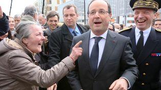 François Hollande a Dijon (Côte-d'Or), le lundi 11 mars 2013. A droite,Pascal Mailhos, préfet de Bourgogne. (MAXPPP)