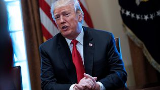 Le président américain, Donald Trump, lors d'une réunion à la Maison Blanche à Washington D.C (Etats-Unis), le 1er mars 2018. (MANDEL NGAN / AFP)
