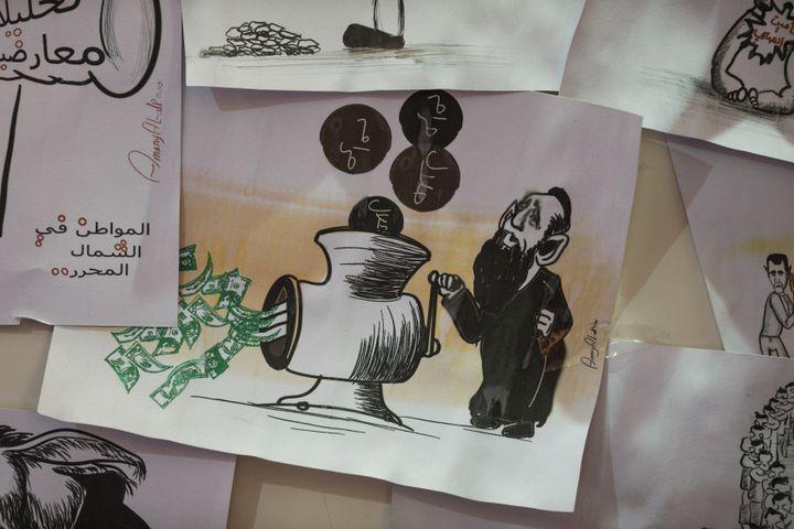 Un dessin de l'artiste syrienne Amani al-Ali. (OMAR HAJ KADOUR / AFP)