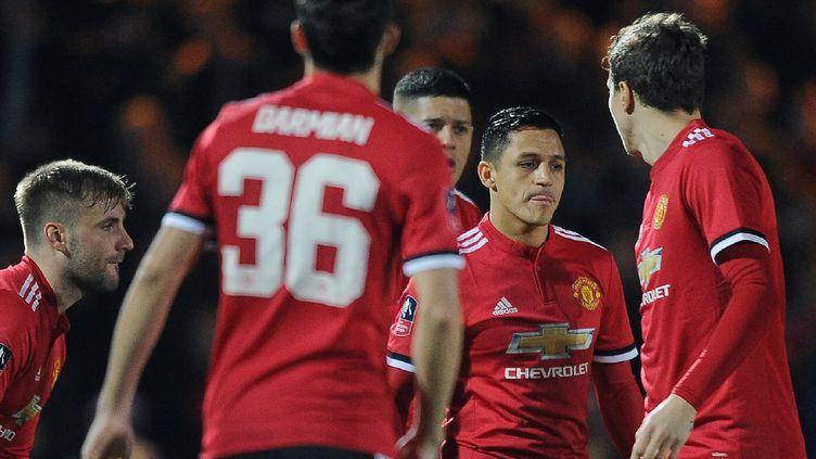 Les joueurs de Manchester United (- / AFP)