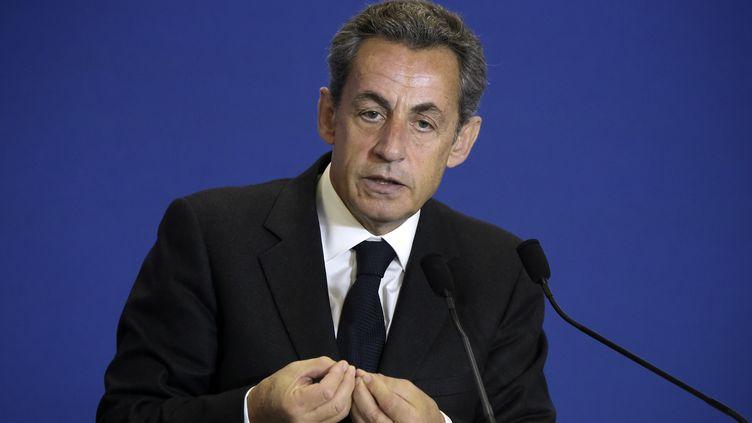 Le président de l'UMP, Nicolas Sarkozy, au siège du parti, à Paris, le 22 janvier 2015. (LIONEL BONAVENTURE / AFP)