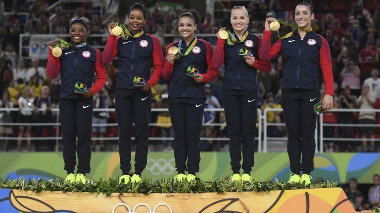 Les Américaines ont conservé leur titre olympique (BEN STANSALL / AFP)