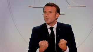 Emmanuel Macron, à l'Elysée, le 14 octobre 2020. (LUDOVIC MARIN / AFP)