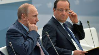Vladimir Poutine et François Hollande, lors du G20 de Saint-Petersbourg (Russie), le 6 septembre 2013. (ILIYA PITALEV / G20RUSSIA / AFP)