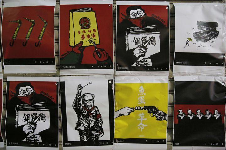 Baducao Caricetures incollato su una libreria a Hong Kong in seguito alla cancellazione di uno di le sue mostre. (Kin Cheung / AP / SIPA / AP)'annulation d'une de ses expositions. (KIN CHEUNG/AP/SIPA / AP)