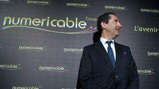 Patrick Drahi, actionnaire principal d'Altice et sa filiale Numéricable, lors d'une conférence de presse le 17 mars à Paris. (ERIC PIERMONT / AFP)
