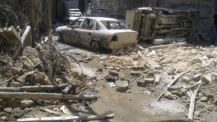 Une rue de Damas détruite lors de combats entre forces de sécurité et rebelles, le 22 juillet 2012. (REUTERS)